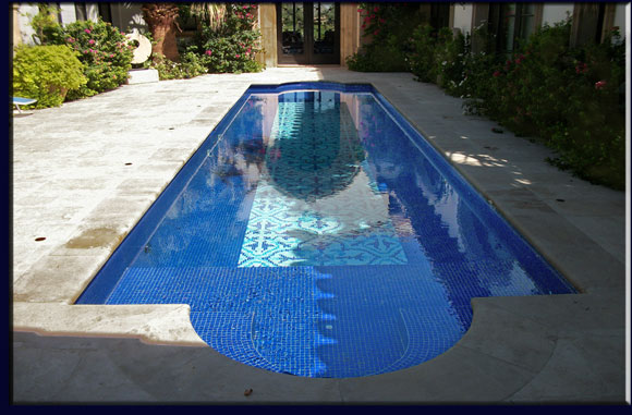 A photo of a fabulous all tile entry way pool